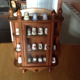 Display case of thimbles