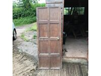 Small, medieval panelled door with antique latch. Attractive and authentic.