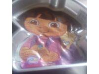 Wilton novelty cake tin.. new..childrens itv charachter DORA the EXPLORER 24x 33 x 5.6 cms Aluminium