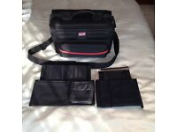 professional camera bag/holdal with velcro pads to make various compartments