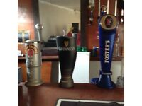 Fosters, John smiths and Guinness pumps ideal for a mancave or home bar