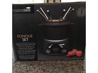 BRAND NEW STILL IN ORIGINAL BOX AND PACKAGING - Black cast iron Masterclass Fondue Set