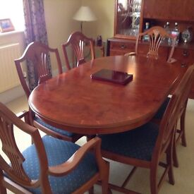 REDUCED £200 Yew dining table.4 chairs and 2 carvers Match. drinks unit avail