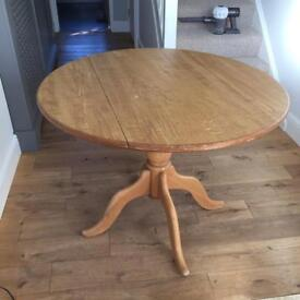Round wooden kitchen / dining table with folding sides