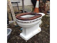 Victorian replica white toilet with decorative stripe around pan and cistern