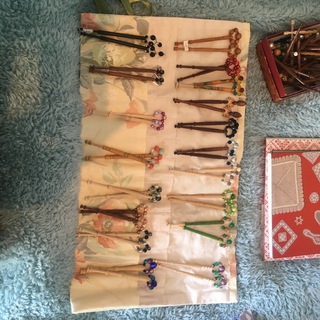 Beautiful wooden lace bobbins with spangles