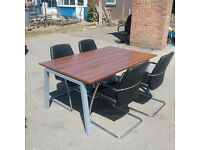Walnut meeting room table without chairs