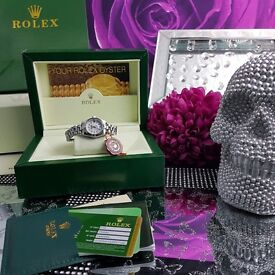 Women's Rolex Datejust box set with white pearl face silver strap