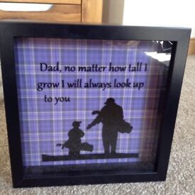 Black framed golf father and son picture