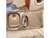 Kitchen sink including tap