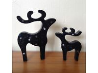 Christmas decorations pair of star gazing hand decorated black with snowflake sparkles reindeer