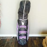 New golf clubs and cart