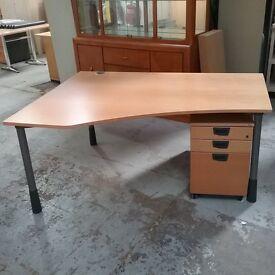 Kinnarps left hand Mid-dark beech effect wavy desk with pedestal
