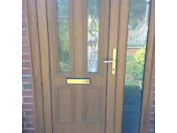 Double glazed door with frame and side glass, upvc light oak effect good condition.