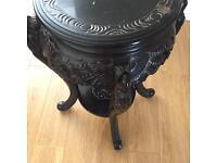 Antique Black carved table .