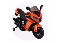 A new and unused 12 volt electric ride on motor bike in orange