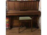 Piano and chair for sale.