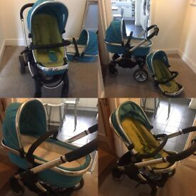 Well used I-candy stroller, carry cot and foot muff with adapters for a car seat and rain cover