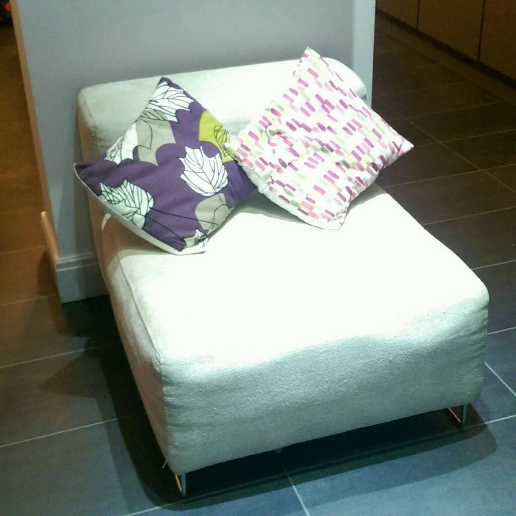 Two cream fabric snuggle chairs
