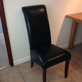 Dining chairs. Six black Faux leather, scroll back, dark legs in excellent condition