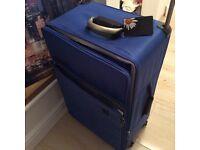 Large suitcase on wheels.
