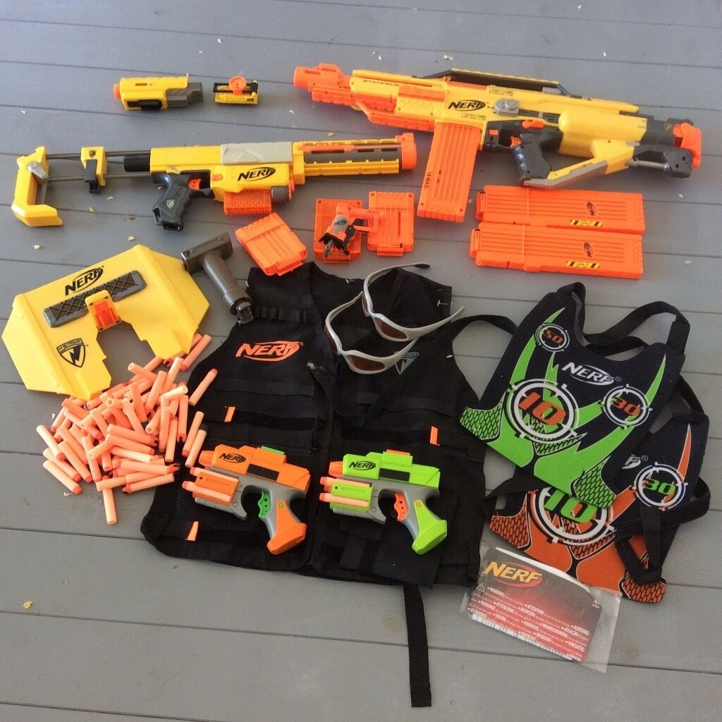 Nerf guns and accessories bundlein Brighton, East SussexGumtree - Keep the kids entertained outdoors. Includes all items as shown in photo Nerf Recon CS 6, Stampede ECS, jolt pistol, duelling set inc vests & goggles & pistols, Nerf tactical vest, magazines and darts