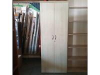 Tall slim grey cupboard with maple doors