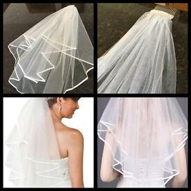 Three different brand new Ivory and white elbow length and cathedral length wedding veils with comb