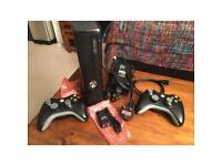 Xbox360S Console with 2 controllers (with regular battery packs) and 2 rechargeable battery packs