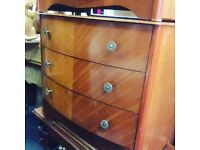 A pair of bow fronted chests of drawers