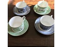 Set of four Wedgwood millennium collection cups and saucers