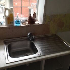Stainless steel kitchen sink and tap