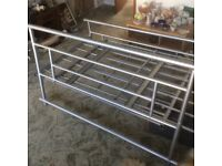 A Metal double framed bed.