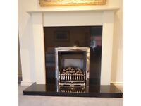 Granite Fireplace with Wooden Mantle and Gas Fire