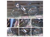 Ladies road bike in new condition used twice many additions added £225 or nearest offer