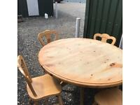 Solid pine round table and 5 matching chairs