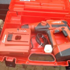 2 HILTI TE . 2.24 volt drills with hammer 2 battery's 2 chargers