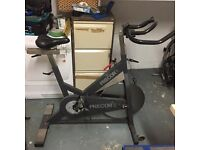 Spinning exercise bike with computer