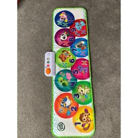 Child's large activity mat by Leap frog.