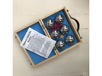 Traditional metal boules set in wooden case