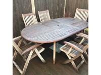 Solid teak table and 6 chairs, parasol base, parasol and cushions