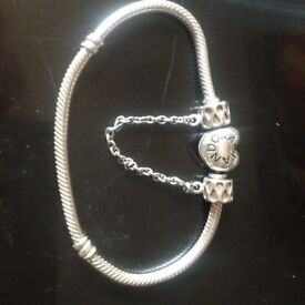 pandora bracelet ,with safety chain charm ,and extra charms