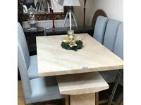 Crema engineered marble dining table
