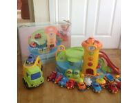 Early Learning Centre whizz around garage, car transporter and vehicles