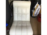 Cream leather swivel chair with foot stool