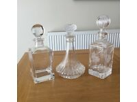 Three cutglass decanters