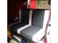 Rock N Roll campervan bed with mattress and seatbelts.