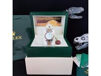 Blue faced Rolex Datejust with roman numerals and gold bezel with all twotone Presidential bracelet