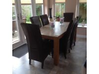 Marble table and 6 leather chairs