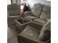 2 seater sofa, 2x armchairs and a glass top table